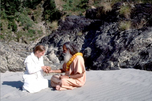 Swami Satchidananda blesses a student